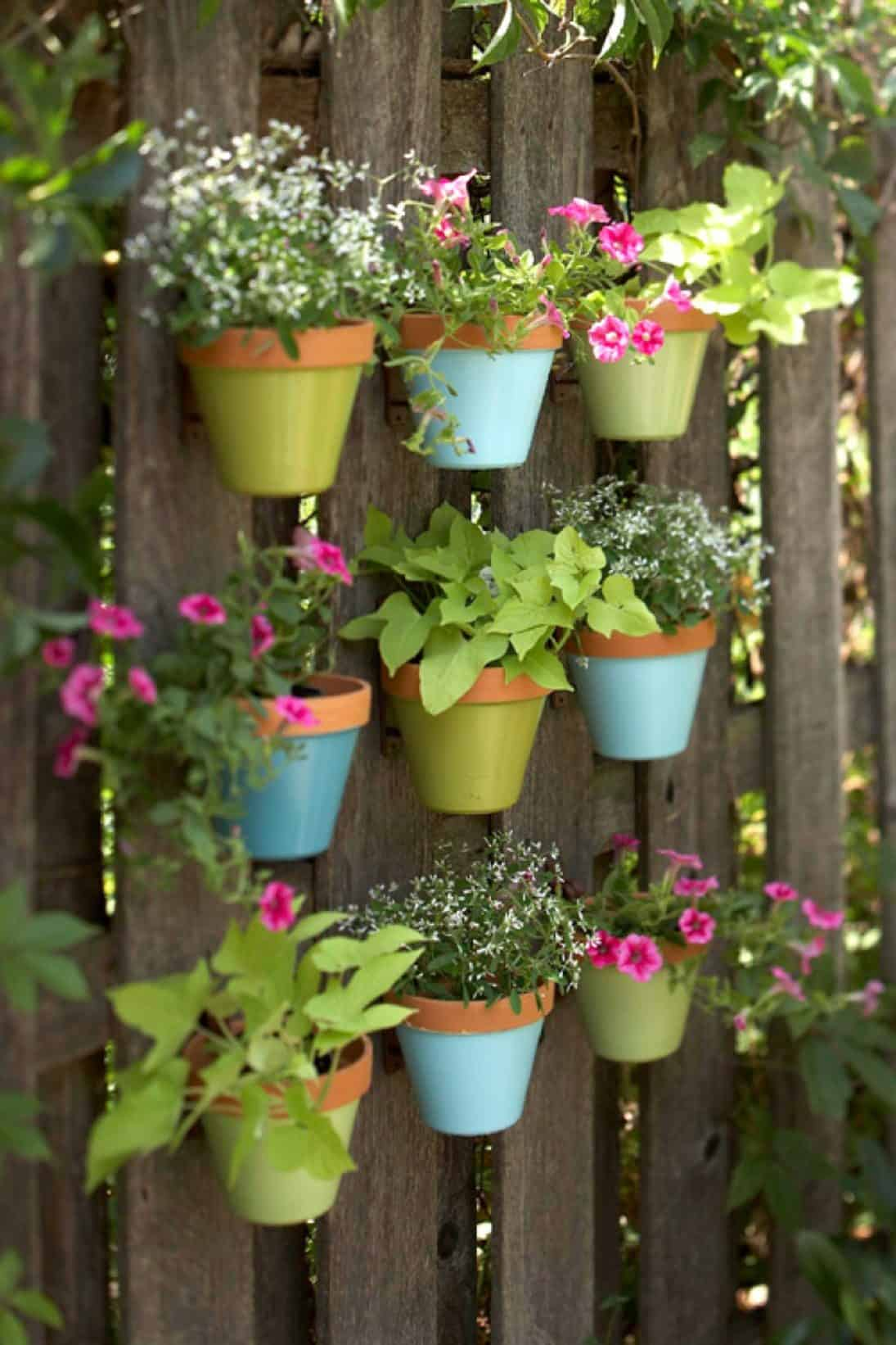 07-pastel-shades-of-blue-and-green-highlight-this-charming-design-vertical-gardens