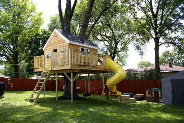 Fun tire-swing below, and a ladder with slide treehouse
