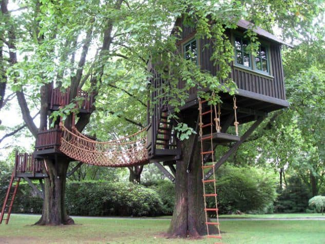 Treehouse with adventurous rope bridge