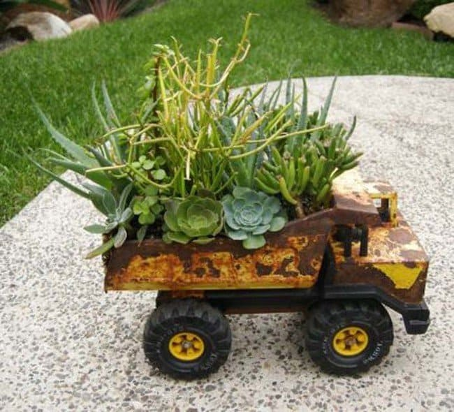Use Old Toys To Create A 'Rustic Planter' Look