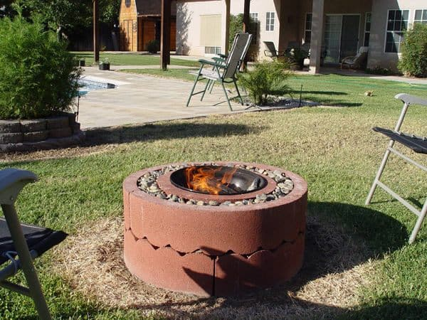 Fire pit made of concrete tree rigs