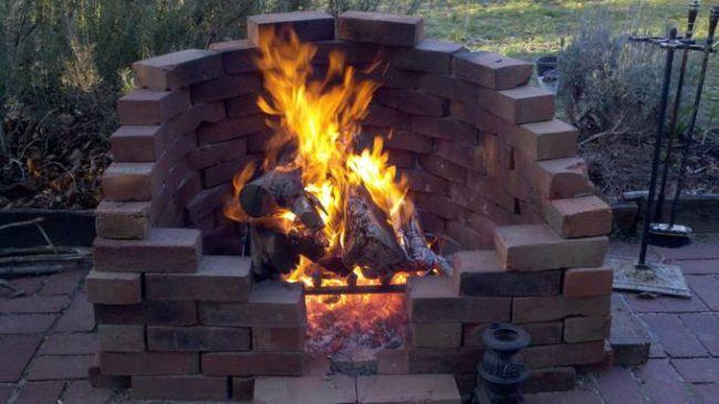 Stacked bricks to create fire pit in backyard