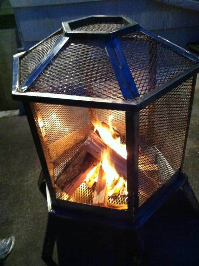 Old metal cage used as an outdoor fireplace