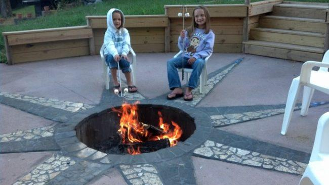 In ground fire pit built into cement patio