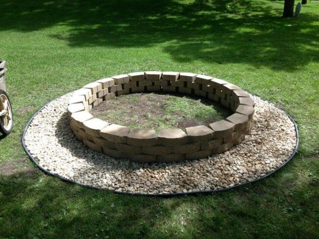 Rough round fire pit made from old masonry stones