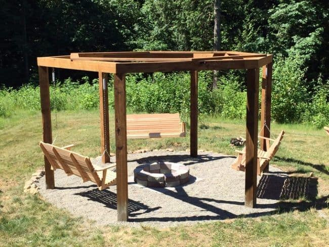 Firepit surrounded by gazebo with swinging benches
