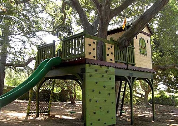 Treehouse with colorful climbing-walls