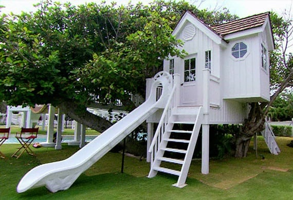 Classic white treehouse with slide