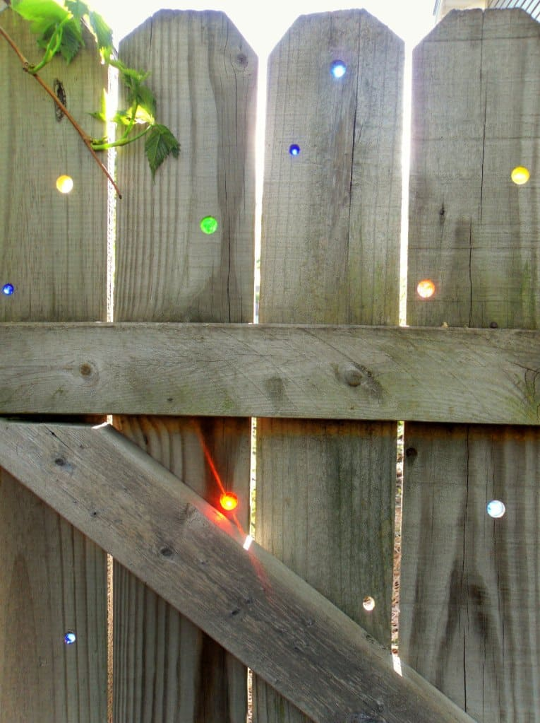 An Artsy Garden Fence Using Marbles