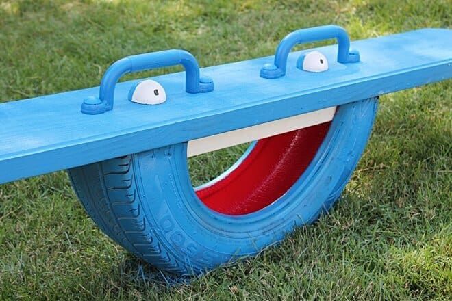 old tire seesaw for kids