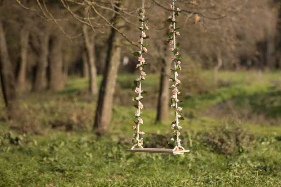 tree swing with entwining faux flowers