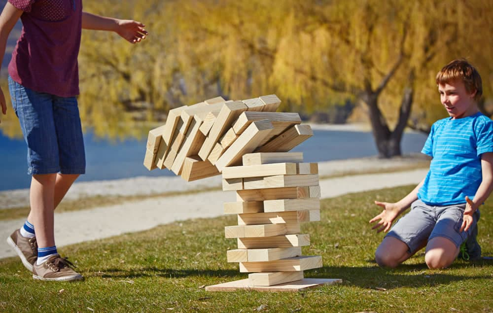 children playing giant jenga