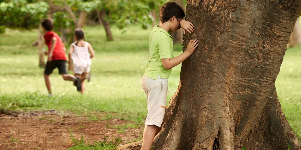children playing hide and seek in the  park
