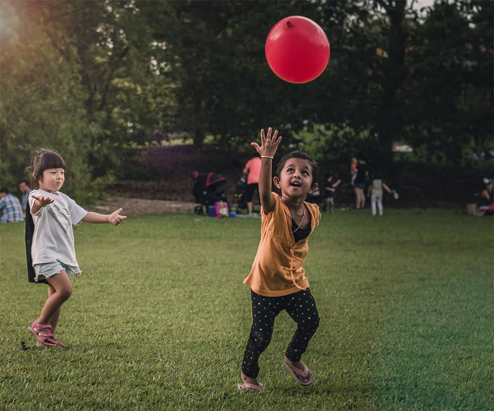 children playing with red balloon