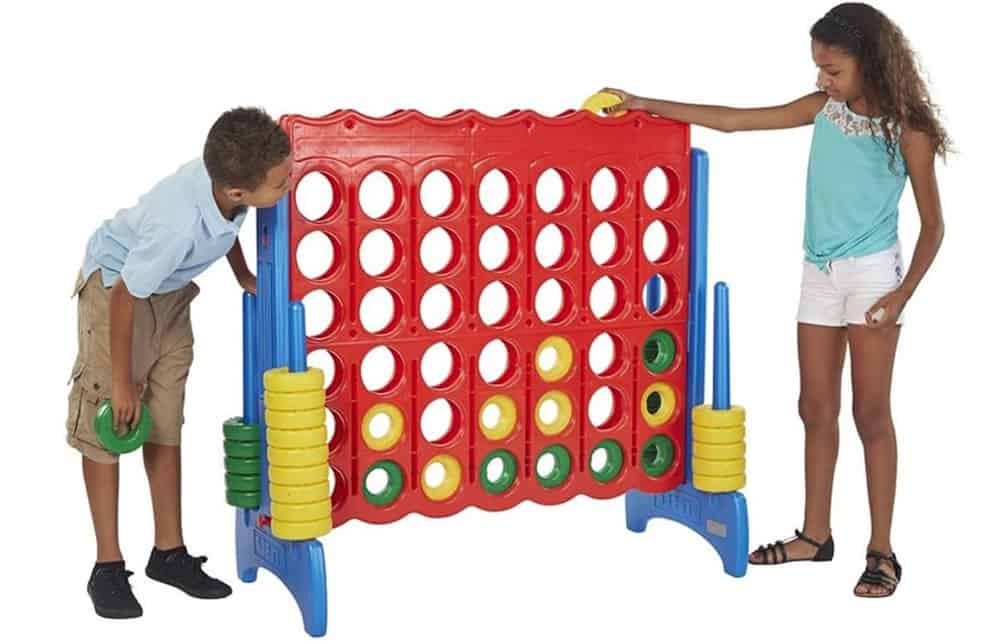 kids enjoying giant connect 4 game