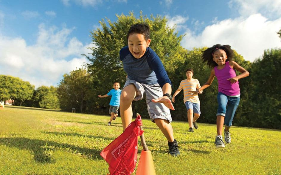 children happily playing capture the flag