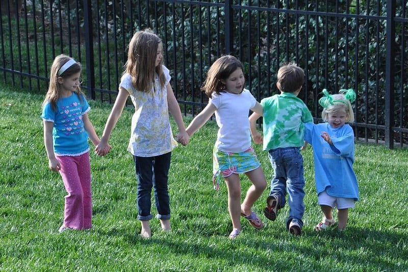kids playing red rover in the backyard