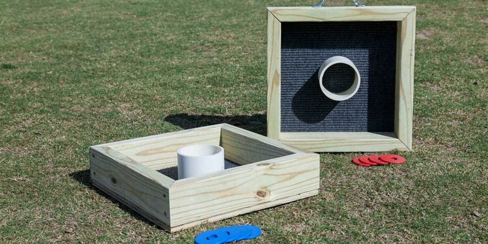 washer toss game on the lawn