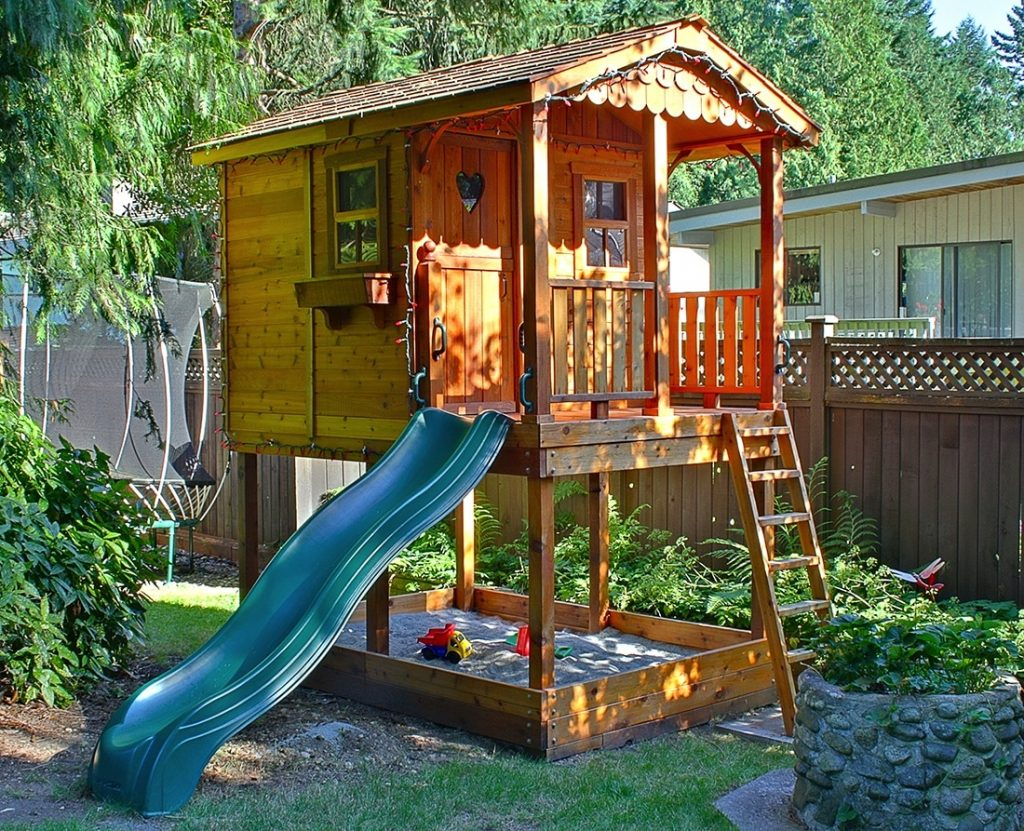 Sunflower playhouse with slide and sandbox