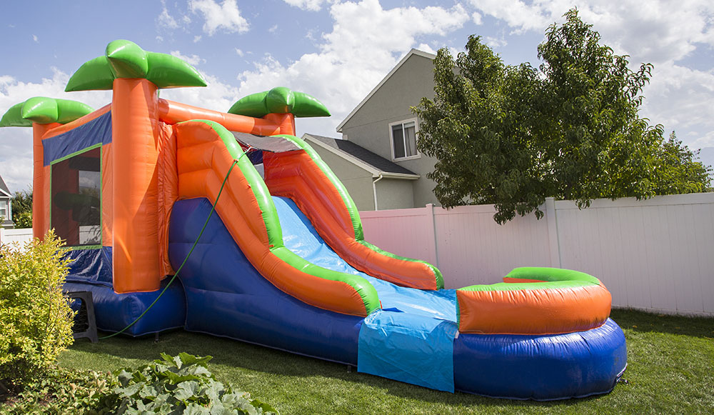 inflatable water slide in the backyard