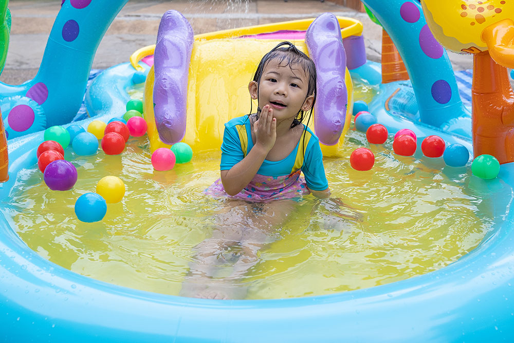 kid in a candy themed water slide pool