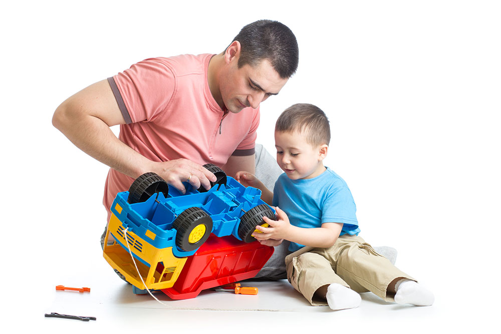 man assembling a-toy with his son