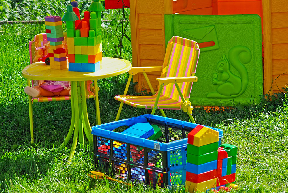 playhouse-in-the-garden-with-lego-toys