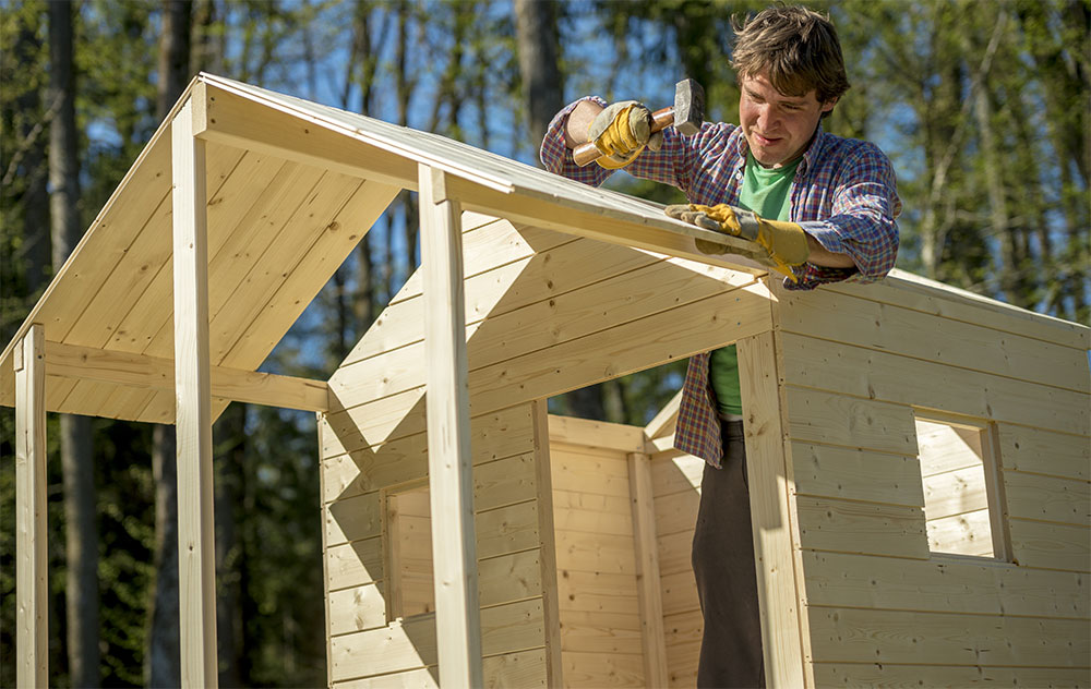 man making a wooden playhouse